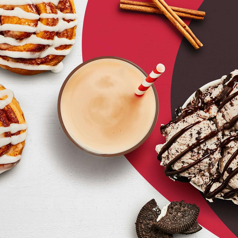 A cinnamon roll Premier Protein shake, next to a Cinnamon Roll, Cinnamon Sticks and Cookies & Cream Ice Cream.