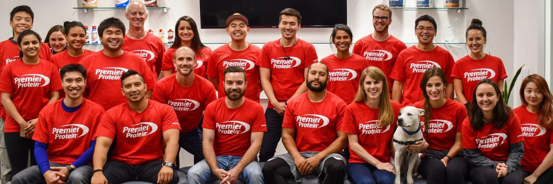 A group of Premier Protein employees and Scout the dog!