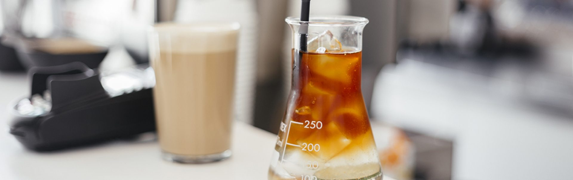 A photo of a protein shake being studied in a lab.