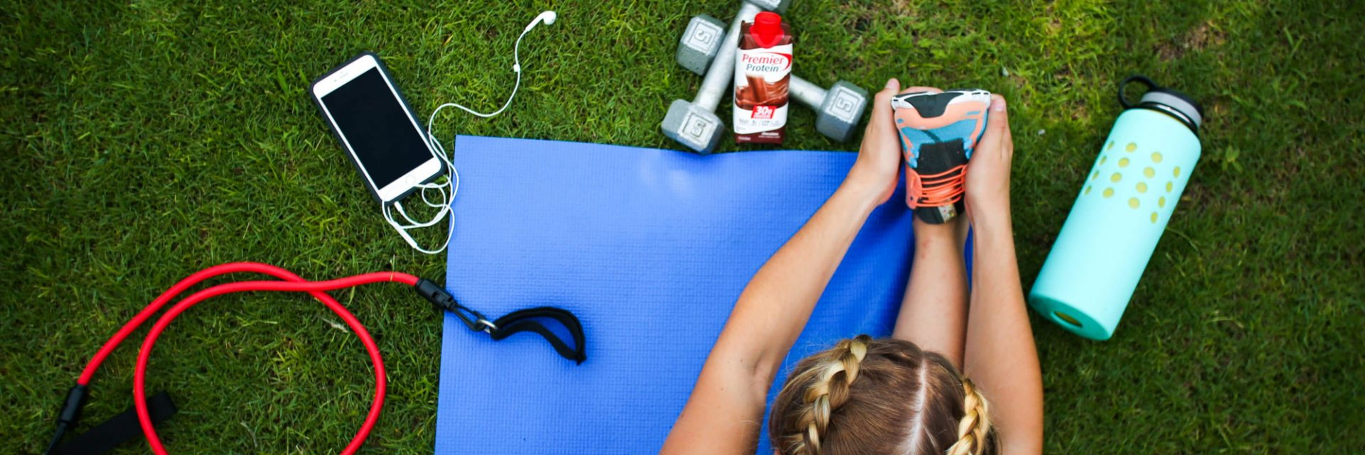 A person exercising with Premier Protein near.
