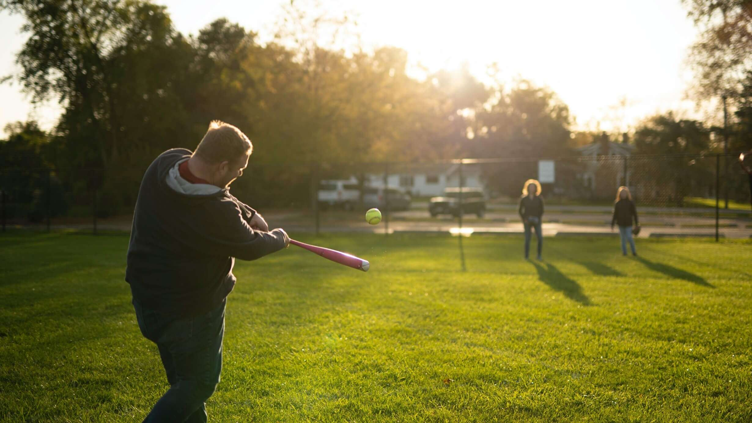 Andy playing softball with his family.
