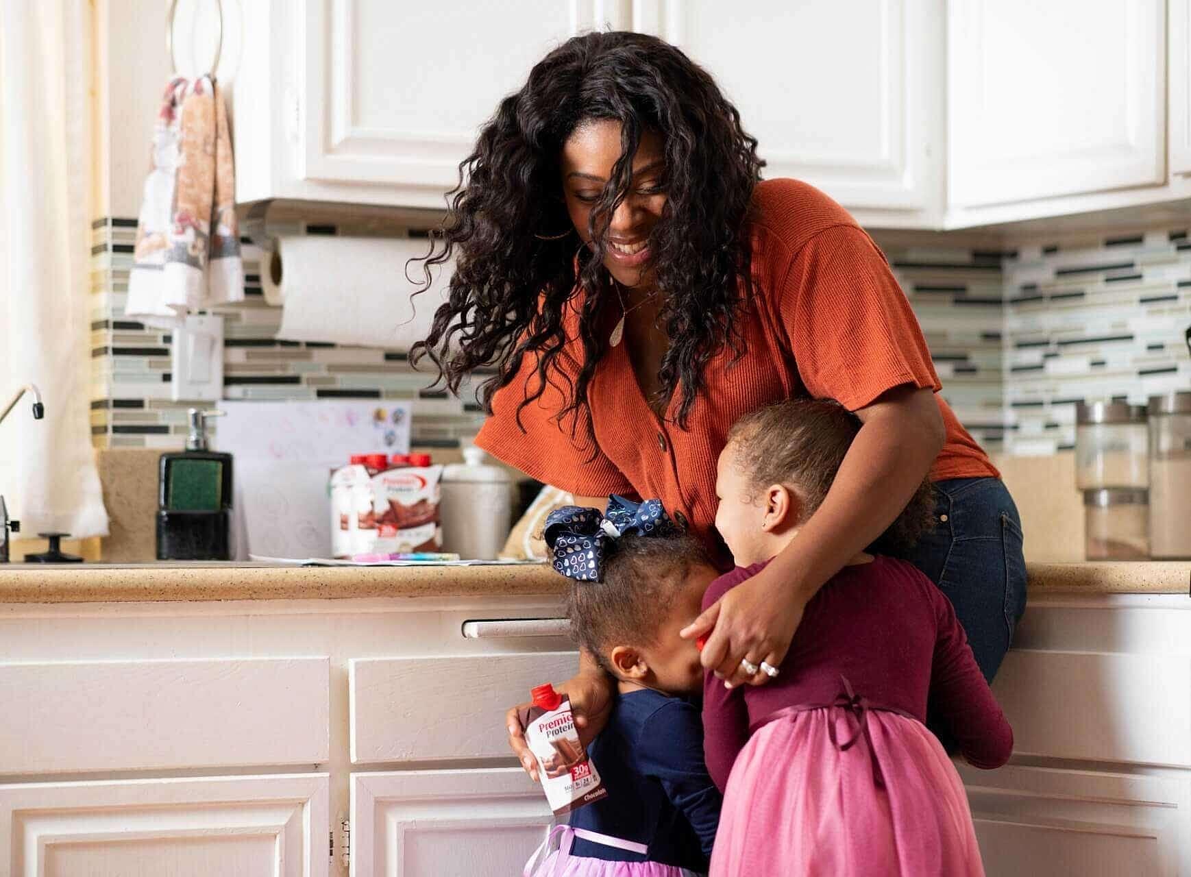 Charmaine in her kitchen with her children.